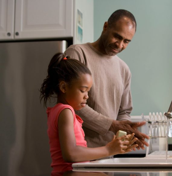 Family doing the dishes in kitchen